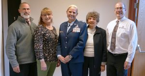 This photo shows Lieutenant Colonel Karen Kramer with her mother, sister, Director of South Hills and the President of South Hills