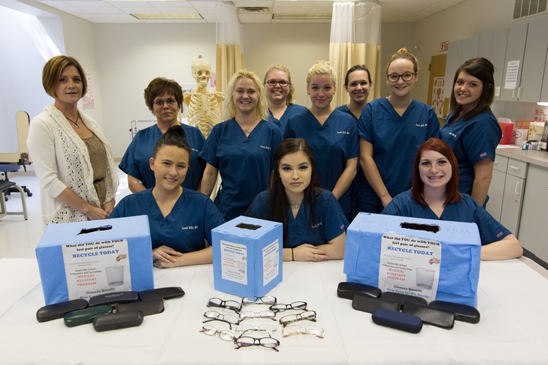 This photo shows a group of medical assistant students smiling