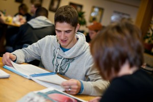 This photo shows a male student studying