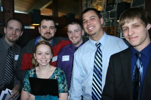 This photo shows a group of smiling students at the career fair