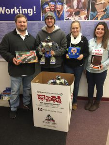 Lewistown students with toy donations for Toys for Tots