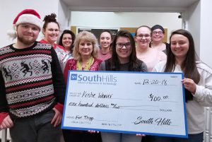 This photo shows Health Careers Club Members with a check for local Lewistown family.