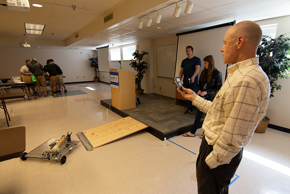 Engineering Technology students running robots through obstacle course