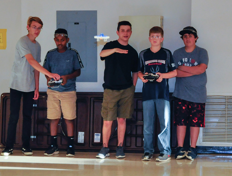 Students from the PA Cyber Charter class take turns flying a drone.