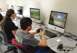 PA Cyber Charter Schools students are shown practicing drone piloting on a computer simulator.