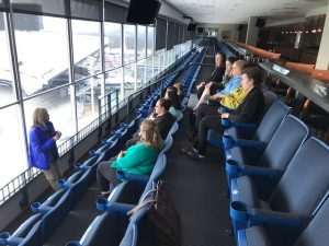 Associate Director of the Office of Donor Relations and Special Events at Penn State University, Amy Pollock, shows South Hills second-year Administrative Professional students the view from the President's Box at Beaver Stadium.