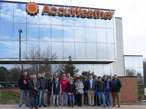 Information Technology students standing outside of AccuWeather in State College