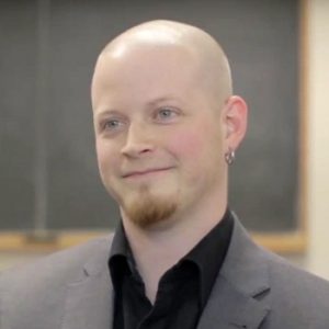 Male smiling in classroom