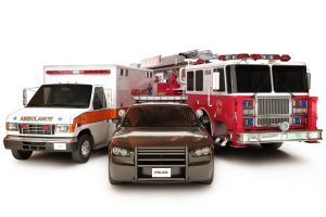 This photo shows an ambulance, police car, and firetruck