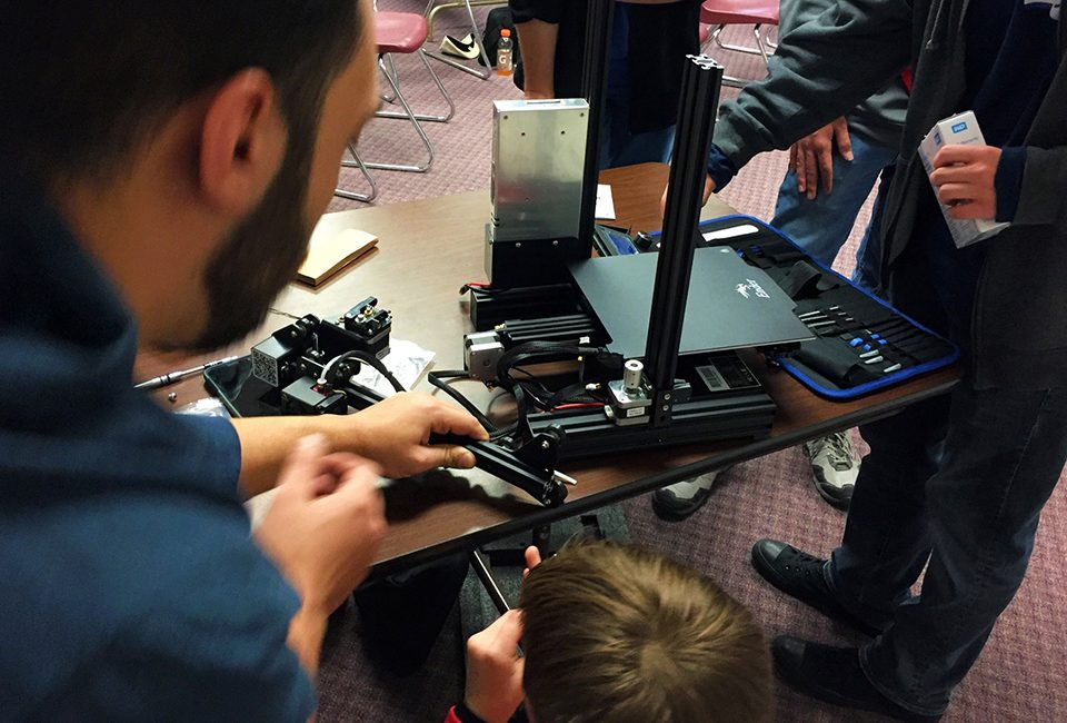 Local Hack Day attendees assemble a 3D printer.