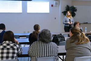 Students are pictured listening to Vicky Barto share her tips for a successful internship.