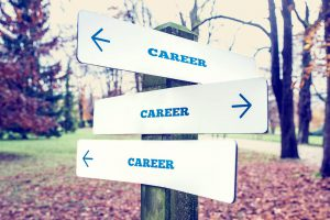 This photo shows the word career with arrows pointing in different directions