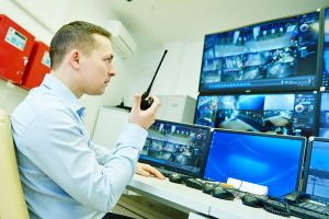 Loss Prevention Specialist monitoring surveillance screens