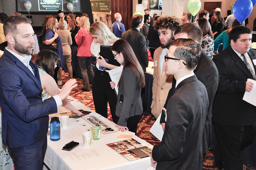 Second-year BAMM Students speaking with Brian Rutter of the Rutter Home Sales Team at Keller Williams Advantage Realty