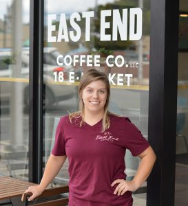 Female standing outside of a coffee shop