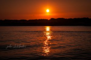 This photo shows a sunset over water