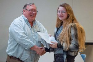 A PA Cyber Charter School student receives her Certified Dronologist certificate from South Hills' Discover Drones Program Coordinator, Jeff Stachowski.