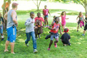 Children running around a yard