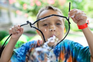 This photo shows a child blowing bubbles
