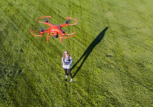 Female flying a drone