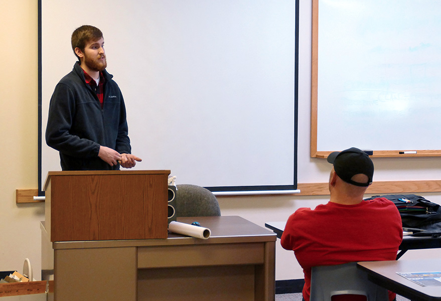 Engineering Technology Graduate Tanner Hutchison speaking to first year Engineering Technology students