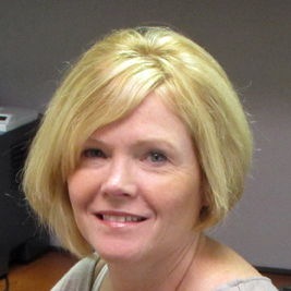 This photo shows Anne Falk, Director of Financial Aid at the State College campus