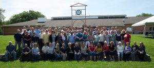 This photo shows faculty and staff outside of the State College main campus