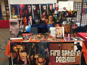 Booth displaying illustrations from Fire Sphere Volume I – The Fire Starter