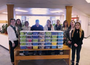 The Health Careers Club and their advisor are pictured with the Jared Boxes they assembled.