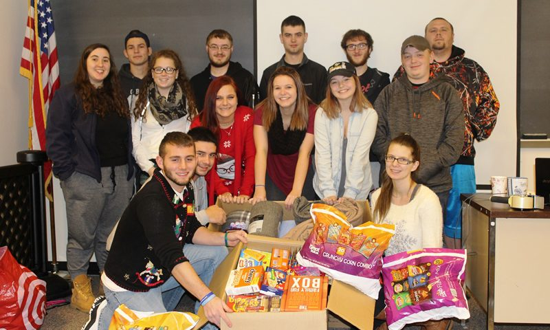 This photo shows a group of students with food donations