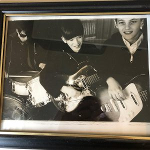 Dave Andrus as a young boy playing guitar