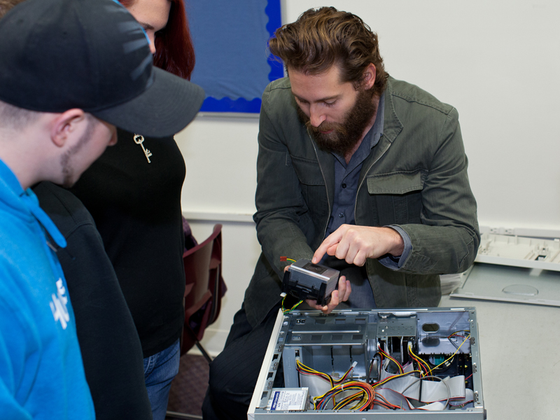 Information Technology instructor showing parts of the computer