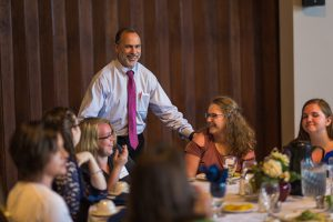 State College Campus Director with students at Appreciation Luncheon
