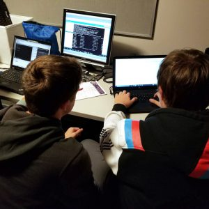 Information Technology students working on a computer