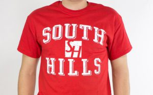 This photo shows a red shirt with a South Hills logo