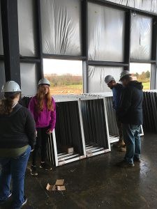 South Hills students inspecting aluminum window frames