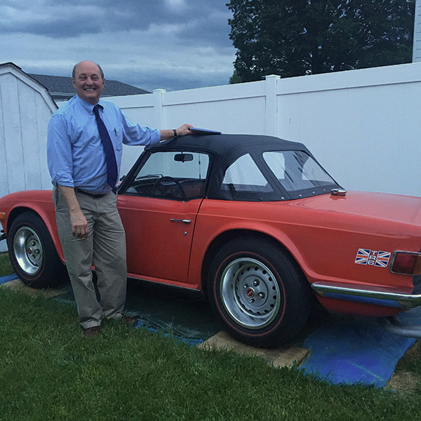 Dave Andrus and his red sports car