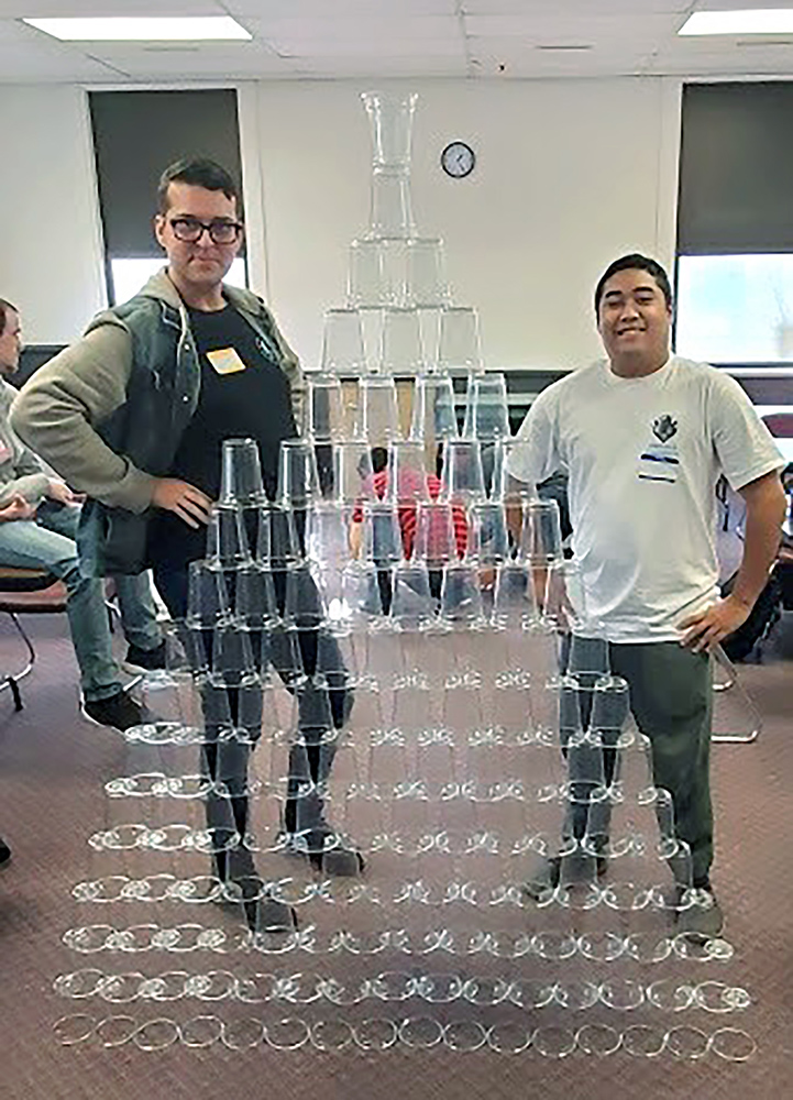 Information Technology students, Jarrod Frederick and Scott Goss, show off their project during the cup-stacking activity. This challenge pushed participants to use analytical skills to build the tallest tower in the shortest amount of time. Although this was not directly related to building hardware or software, strategic thinking and a problem-solving mindset was needed to win.