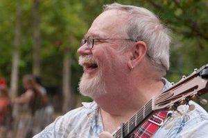 Jim Colbert playing guitar
