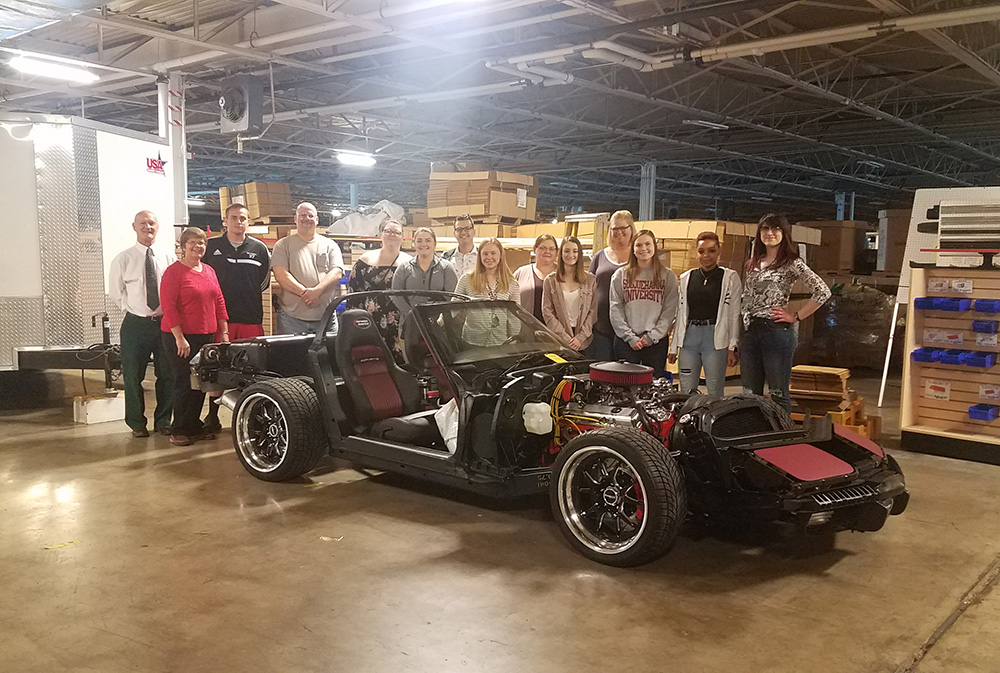 L to R: South Hills Instructor Harry Geedey and Advertising & Marketing Supervisor of Corvette America Susie Canon with South Hills students Noah Brackbill, Frank Jost, Emily Slater, Shania Teenie, Jordan Bennett, Brooke Hosler, Lexi Wagner, Madalyn Cisney, Paula Hoffman, Mackenzie Wagner, Danika Hassett, and Haley Kipp