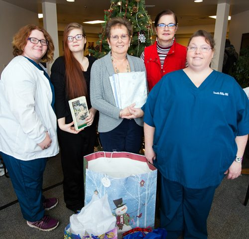 Health Careers Club members holding donations for a local Nursing facility