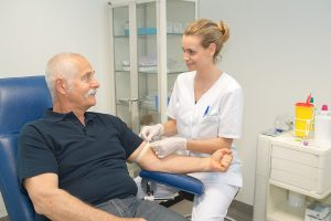 Phlebotomist collecting a patient's blood for testing