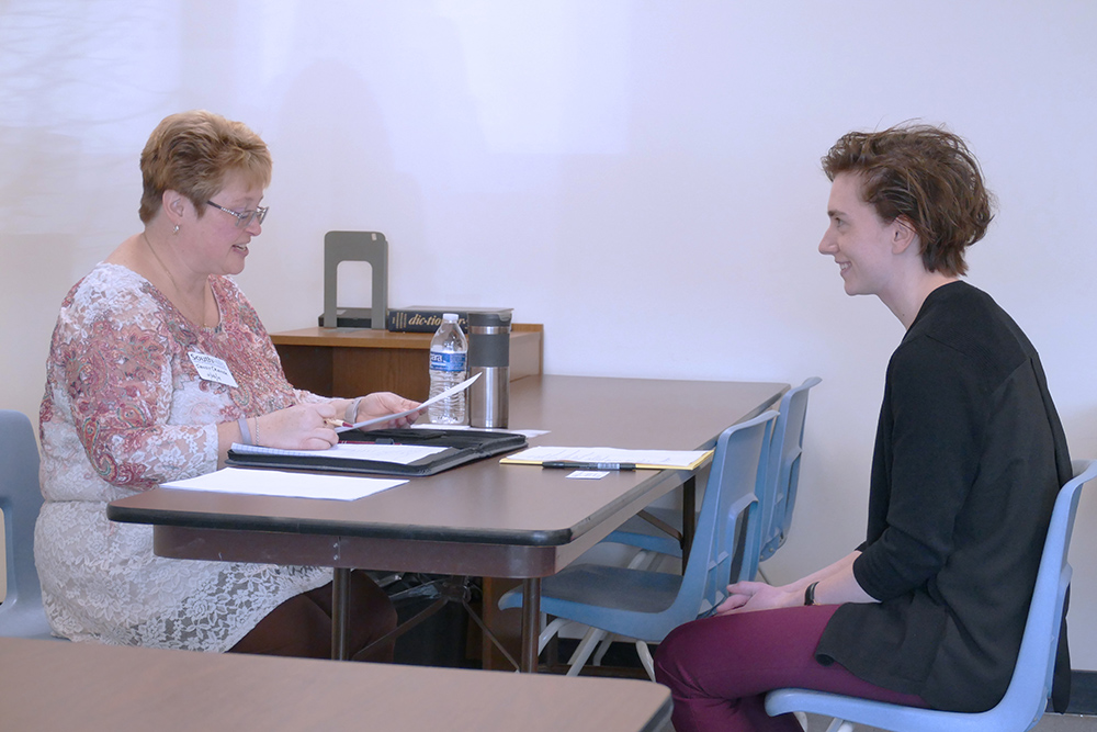 Sandy Cramer, Co-Owner of the HR Office, Inc., conducts a mock job interview with a South Hills student.