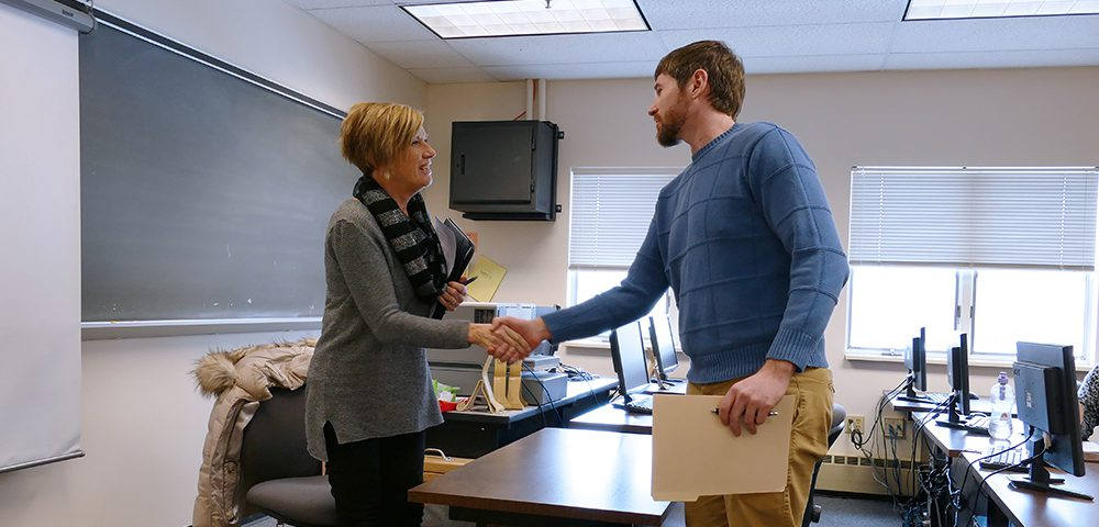 Leanne Condo, Human Resource Manager at Blatek, greets Daniel Vandrew, second-year Engineering Technology student, at the start of his mock job interview.