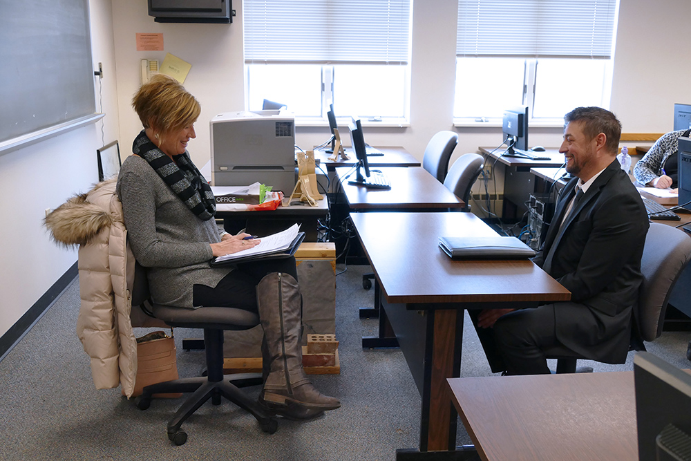 Leanne Condo, Human Resource Manager at Blatek, conducts a mock job interview with a South Hills student.
