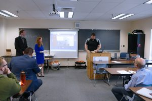 Criminal Justice students present their capstone projects to an audience.
