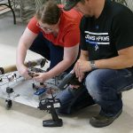 Engineering Technology students with their robotic vehicle