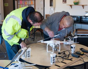 Two males working on a drone