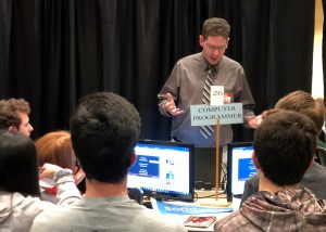 Information Technology Instructor speaking to students