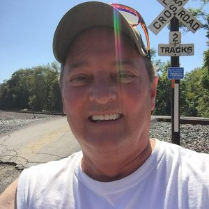 Dave Andrus by the railroad tracks